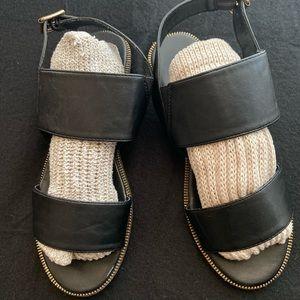 Black strap sandals.